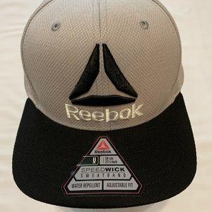 Reebok baseball cap ( new ) 22 7/8 adjustable fit.